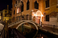 Venetian canal at night. Canal and pedestrian bridge in Venice, Italy, at night Royalty Free Stock Photos