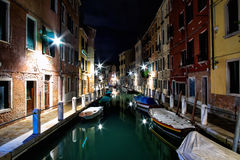 Venice at night. Beautiful reflections of colorful houses and boat in Venice  at night Royalty Free Stock Photos