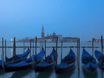 Venice at night with gondolas in the foreground Royalty Free Stock Images