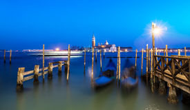 Venice night seascape after sunset. Blurred Gondolas long exposure Royalty Free Stock Image