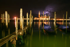 Venice night a storm. Night Venice and lightning, gondolas and poles, night atmosphere, coming storm stock photography