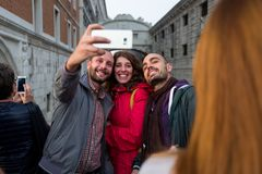 Venice - October 04: Unknown tourists make a selfie in front of the famous Ponte dei Sospiri bridge on October 04, 2017 Stock Photo