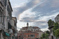 Venice old architecture at sunset with dramatic sky, Italy. Royalty Free Stock Images