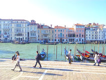 Venice. Old big house, various building, near water in Venice Italy. Italian history architecture on sunshine, people walking and boats in water stock images