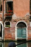 Venice, old gate on the water stock photography