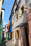Old street in Burano - Venice Stock Photo
