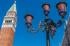Venice with  old street lamps and tower. Venetian old lamp and tower, Italy Royalty Free Stock Images