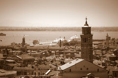 Venice panorama Italy. Panoramic aerial view of Venice with Santa Maria Gloriosa dei Frari church tower at the foreground, cruise ships docked at the passenger Stock Photos