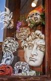 Venice, papier mâché masks at artisan shop window Royalty Free Stock Photo