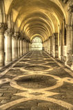 Venice Passageway. A passageway in Venice with repetitive arches Royalty Free Stock Image