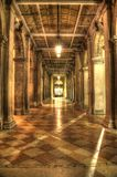 Venice Passageway. A passageway in Venice with repetitive columns and bands of light Stock Image