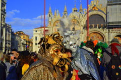 Venice piazza masked people Royalty Free Stock Photography