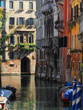 Venice - Picturesque Canal. A colourful canal scene with those blue and white stripe poles Stock Images