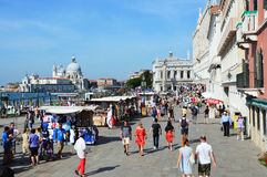 Venice promenade with tourists in sunny day, Venice, Italy. VENICE, ITALY - AUGUST 9, 2016: Venice promenade with tourists in sunny day, Venice, Italy Stock Image