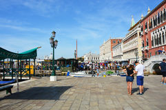 Venice promenade with tourists in sunny day, Venice, Italy. VENICE, ITALY - AUGUST 9, 2016: Venice promenade with tourists in sunny day, Venice, Italy Stock Photo