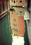 Venice reflection. A small river of Venice and the reflection of an old hotel Royalty Free Stock Image