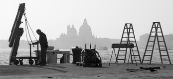 Venice - Repair on the waterfront and silhouette of Santa Maria della Salute church. Stock Images