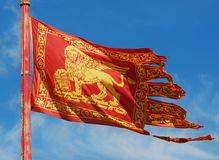 Venice Republic Flag. Old Venice Republic Flag with Saint Mark Lion fluttering in the wind stock photography