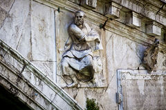 Venice, Rialto Bridge across the Grand Canal, carved statue detail royalty free stock image