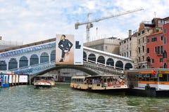 Venice. Rialto Bridge, waterbus stop and vaporetto in Grand Cana Royalty Free Stock Photo
