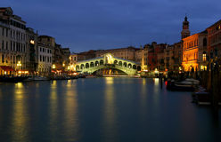 Venice Rialto at night. At the evening around the canal, the rialto bridge under lights royalty free stock image