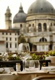 Venice romantic drink. Closeup of empty wine glasses in Venice, Italy Royalty Free Stock Images