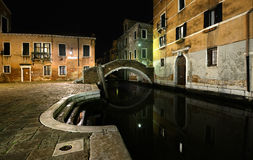 Venice. 's narrow streets in the evening with a bridge over the canal Stock Image