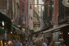 Venetian alley crowded. Venice`s very characteristic alley full of tourists intending to visit the city Royalty Free Stock Image