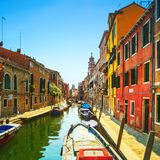 Venice San Barnaba cityscape, water canal, church and boats. Ita Stock Photo
