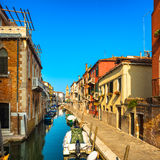 Venice San Barnaba cityscape, water canal, church and boats. Ita Royalty Free Stock Images