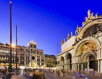 Venice San Marco Cathedral Blue Set. San marco square of Venice between Cathedral and Yex Change S.R.L. A Socio Unico at sunset with blurred crowd of tourists Royalty Free Stock Images