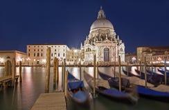 Venice - Santa Maria della Salute church and gondolas in evening Royalty Free Stock Photo
