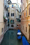 Venice scenic. Gondolas in canal in Venice, Italy Royalty Free Stock Photography