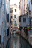 Venice scenic. Small bridge over a canal in Venice, Italy royalty free stock photo