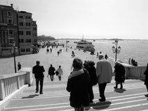 Venice seaside view. Group of people walking down the stairs royalty free stock photography