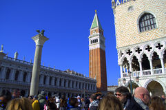 Venice sight. Extremely busy square(Piazzetta) between the Doge's Palace and Biblioteca (Library),St Mark's Campanile (Campanile di San Marco)- the bell tower of Stock Images
