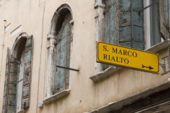 Venice sign pointing to San Marco Square Royalty Free Stock Photos