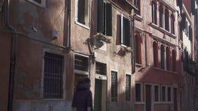 Venice silent back street people crossing stock video footage
