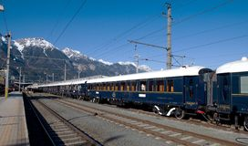 The Venice Simplon-Orient-Express in Central station Innsbruck. Innsbruck Austria APRIL :The legendary 'Orient Express' arrives at station in Venice am on April royalty free stock image