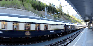The Venice Simplon-Orient-Express in motion. St. Anton am Alberg - station- Austria MAY 04:The legendary 'Orient Express' arrives at station in London at 10:45 stock photography