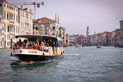 Venice, Snaly. Vaporetto with passengers floats on the Grand channel (Canal Grande). Stock Photos