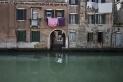 Venice is a beautiful town on the sea in Italy. Small romantic canal, old buildings and traditional venetian houses. Venice is a special town on the sea in Italy royalty free stock photo