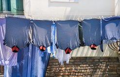 Venice street, famous gondoliers t-shirts, Venice,Italy. Venice street, famous gondoliers stripes t-shirts, Venice,Italy.Italian street, laundry Stock Photos