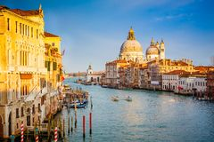Venice at sunny evening. Grand Canal and Basilica Santa Maria della Salute illuminated by evening sun Royalty Free Stock Photography