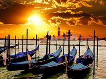 Venice sunrise. Vibrant sunrise over the lagoon of Venice, Italy with gondolas Royalty Free Stock Images