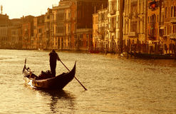 Venice sunset. Gondolier with gondola on Grand Canal in Venice, Italy during sunset Royalty Free Stock Images
