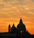 Venice sunset. Sun setting behind the basilica in venice royalty free stock photos