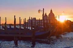 Venice at sunset. Cityscape with gondolas, Venice at sunset stock photo