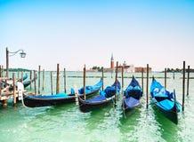 Venice sunset, gondolas or gondole and church on background. Italy. Venice sunset, gondolas or gondole on a blue sky and San Giorgio Maggiore church landmark on royalty free stock image