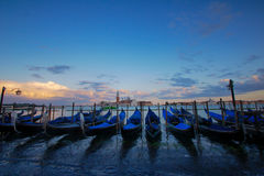 Gondolas in Venice - sunset with San Giorgio Maggiore church. San Marco, Venice, Italy royalty free stock photography